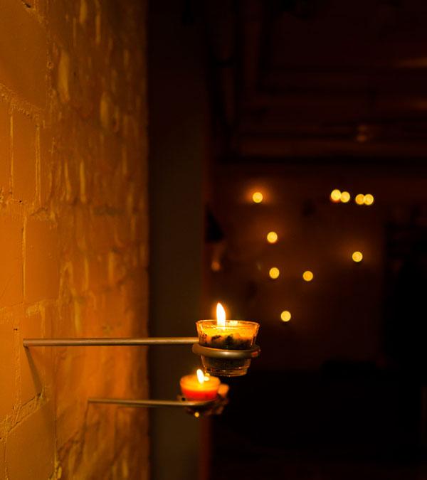 Wall candle holder at Alusi Ephemeral Art Berlin by WACH designstudio