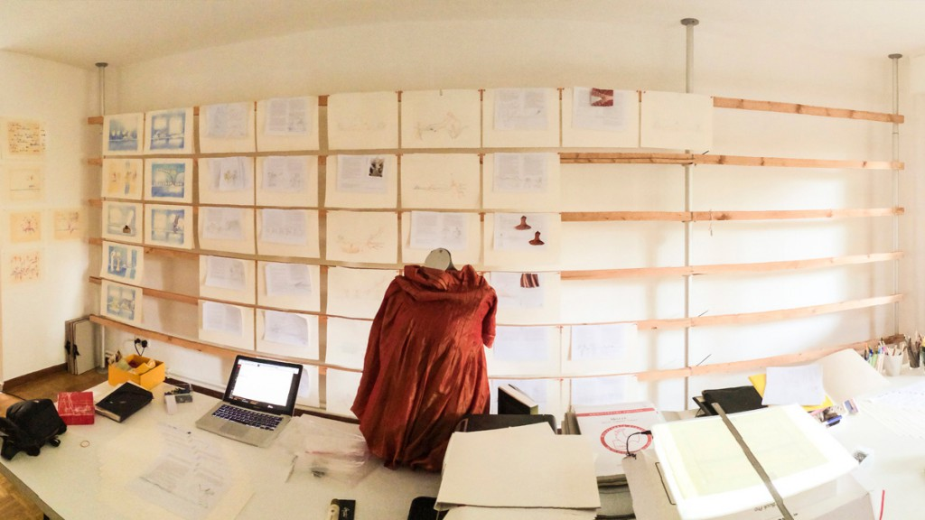 Moments of Happiness workspace with all pages hanging on the wall